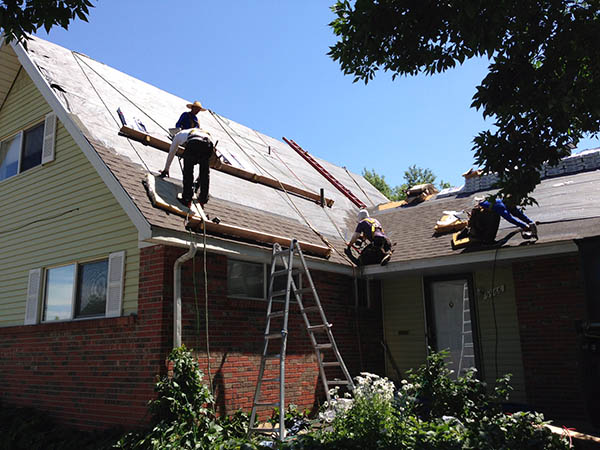 smart roofing provide roof restoration in denver, denver roof replacement, and storm damage restoration